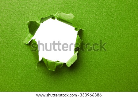 Green torn paper with place for text - stock photo