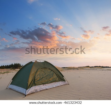 green touristic tent on a sand