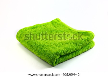 Green towel handkerchief isolated on white background closeup