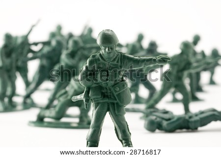 Green toy army engaged in battle - stock photo
