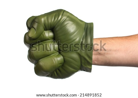 Green toy fist on a white background - stock photo