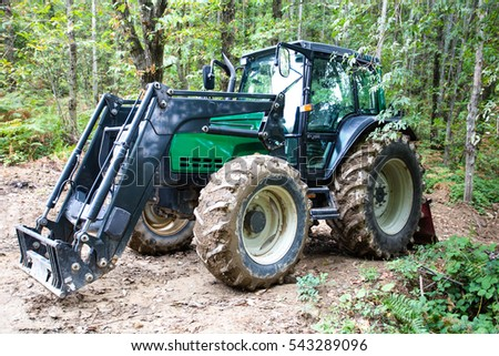 Green tractor in the woods