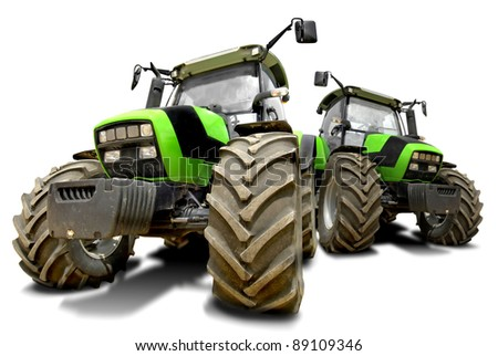 Green tractors isolated in white - stock photo