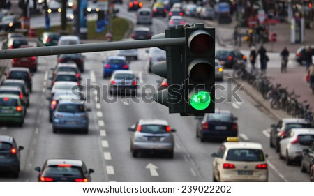 Green traffic light, big city traffic - stock photo