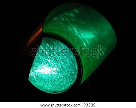 Green traffic light by night - stock photo