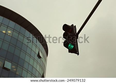 Green traffic light in the city, Traffic lights against sky backgrounds, vintage color filter - stock photo