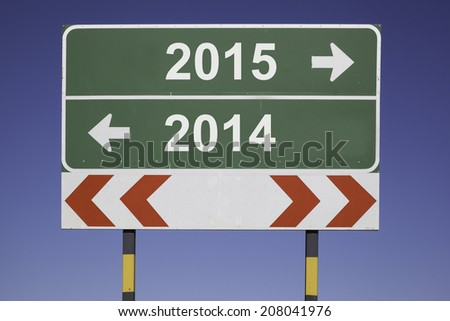 green traffic sign in front of a blue sky, horizontal arrows showing two directions and a red white road warning post. Business concept for fiscal year change 2014, 2015 - stock photo