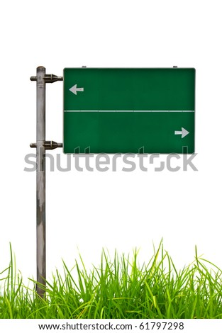 Green Traffic sign  on grass - stock photo