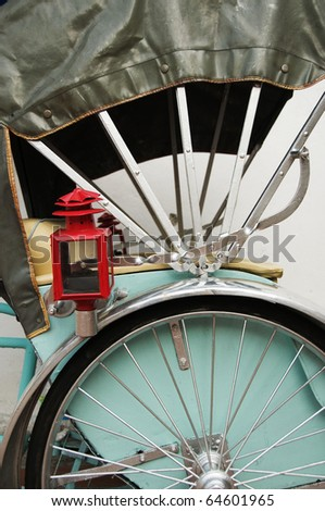Green Trishaw - stock photo