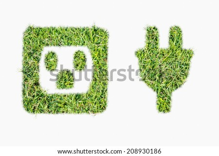 Green turf power plug and outlet made of green grass - stock photo