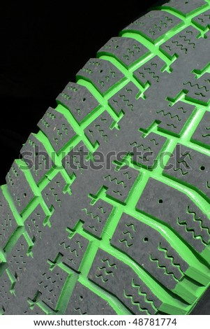 Green used tire - stock photo