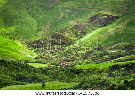 Green valley in the mountains of Tuscany - stock photo