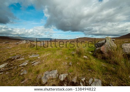 Green valley on summertime in Scotland. - stock photo