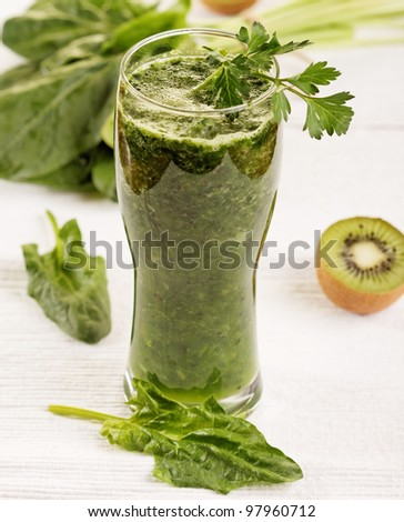 Green vegetable smoothie on white background