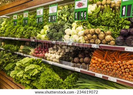 Green vegetables at a market stall - stock photo