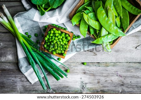 Green vegetables on wooden background - stock photo