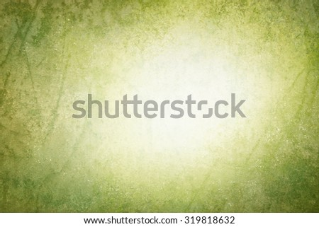 green vintage background texture with blurred white center copyspace - stock photo