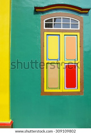 Green wall and windows in indian culture - stock photo