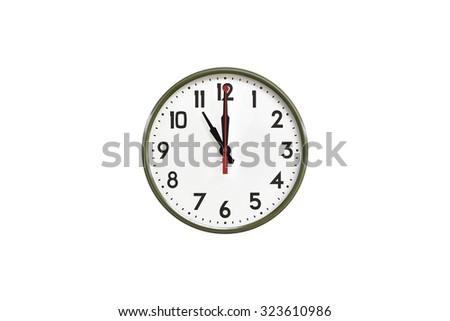 Green wall clock.Eleven o'clock - stock photo