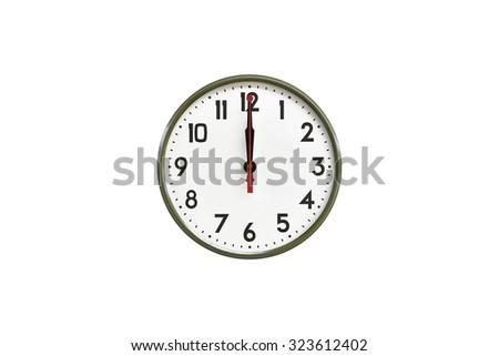 Green wall clock.Twelve o'clock - stock photo