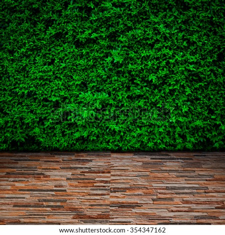 Green wall texture background with stone tile floor. - stock photo