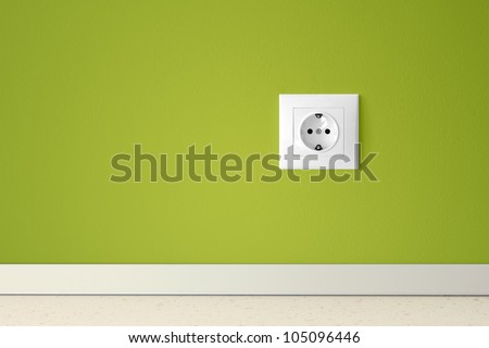 Green wall with european electric outlet.Conceptual. - stock photo