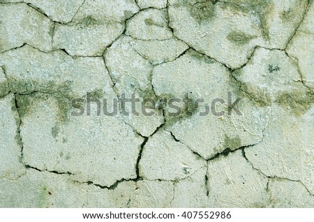 Green wall with plaster all in the cracks under the influence of weather. textural composition - stock photo
