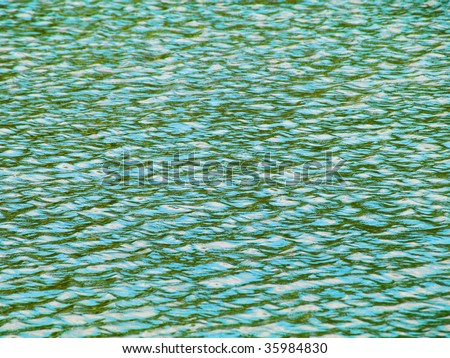 Green water background with some small waves