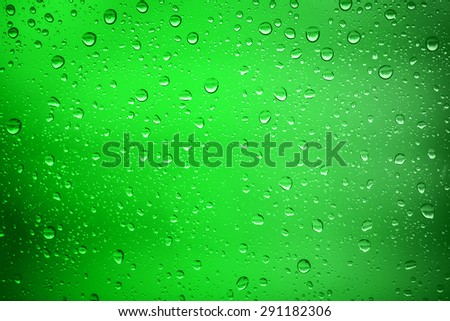 Green water drops on background - stock photo