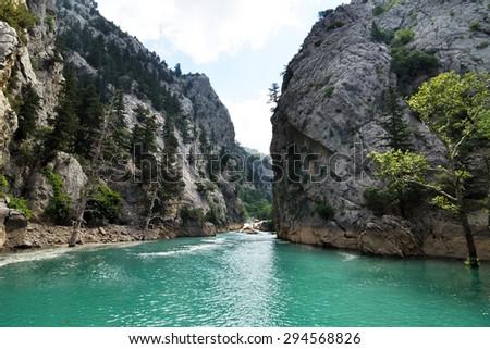 Green water lake Green Canyon in Turkey flowing between mountains covered with trees - stock photo
