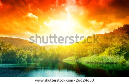 green water lake in forest and sunset - stock photo