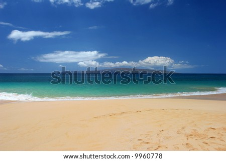 Green water of a Tropical beach in Maui - stock photo