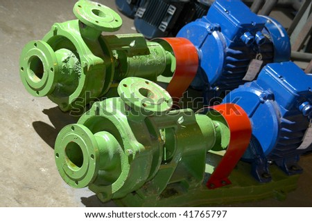 Green water pumps - stock photo