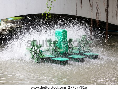 Green Water turbine working in pool - stock photo