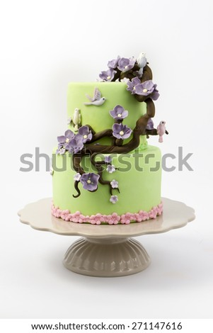 green wedding cake on white background - stock photo