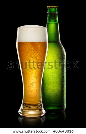 Green wet Bottle of beer and glass of beer on black background. - stock photo