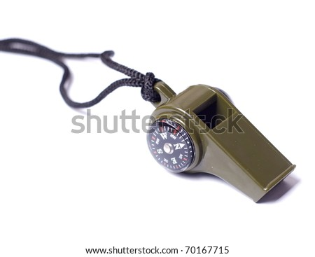 green whistle with a compass on a black cord - stock photo