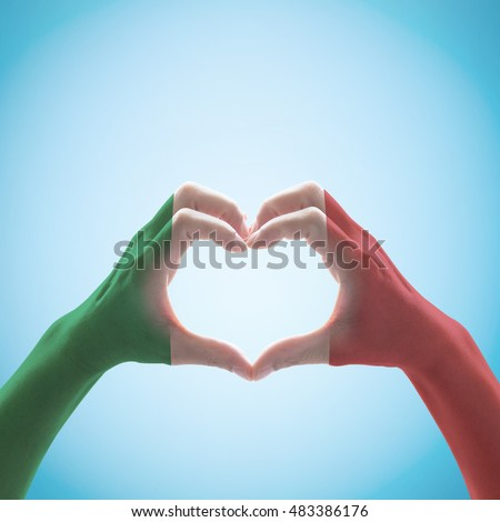 Green white red color national flag pattern on people hands heart love shape (clipping path) on blue sky for unity, labour, friendship, harmony nation support: Holiday day celebration symbolic concept