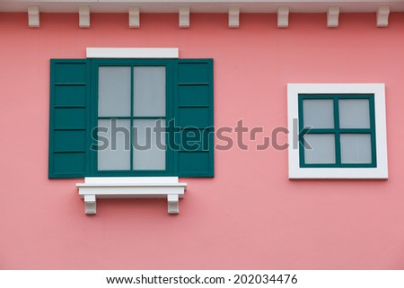 Green window and Pink wall - stock photo