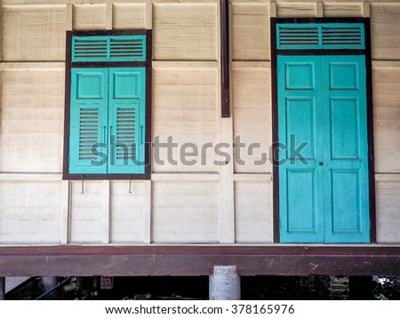 green window and the door made of wood thai style