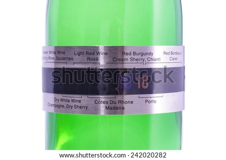 Green wine bottle with steel band thermometer close up isolated - stock photo