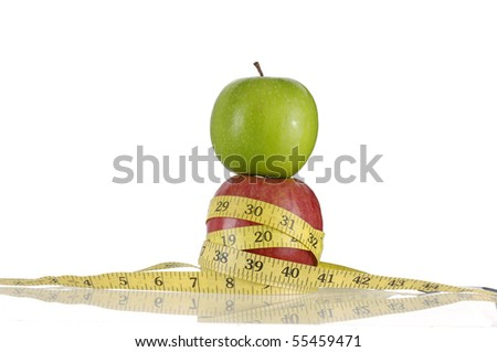 green with red apple and tape measure