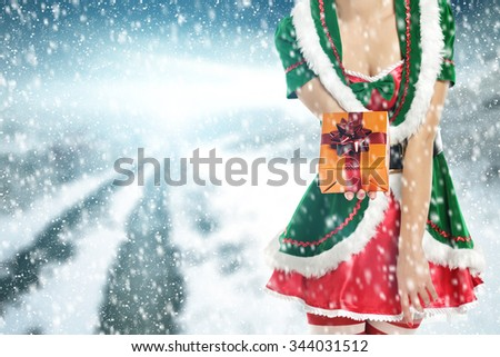 green woman and box and road and snow and space for you  - stock photo