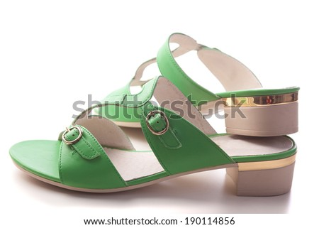 Green women sandals shoes isolated on white - stock photo