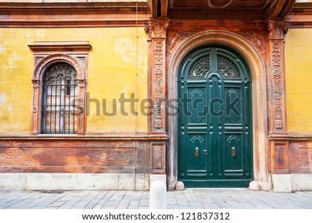 green wooden door of medieval house in Ferrara, Italy - stock photo