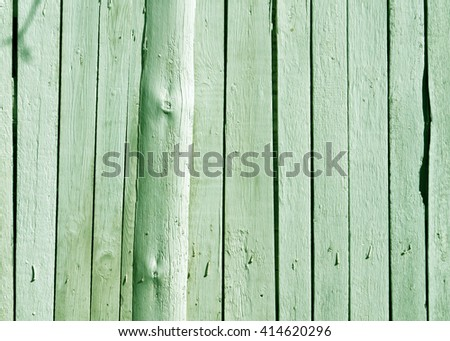 Green wooden fence texture. Backgrounad and texture for design. - stock photo