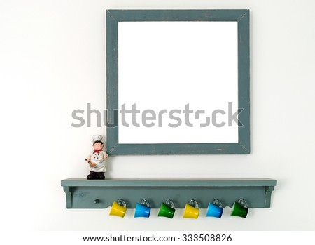 Green wooden frame and shelf with,small colorful glass hang on the wall. - stock photo
