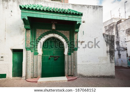Green wooden gate of ancient mosque in Medina. Tangier, Morocco - stock photo