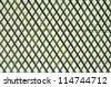 Green wooden lattice wall. - stock photo