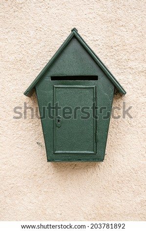 Green Wooden mail box on the wall - stock photo